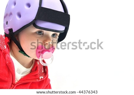 baby in safety helmet - stock photo