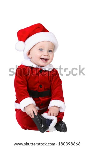 Baby in santa outfit on white background