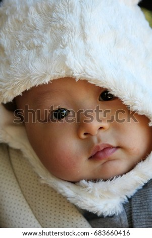 Baby in the white winter hat