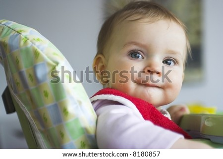 Baby in toddler seat - smiling - stock photo