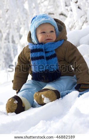 Baby in winter on snow - stock photo
