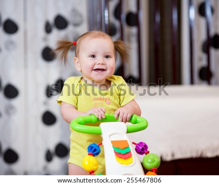 baby infant standing with support at home - stock photo