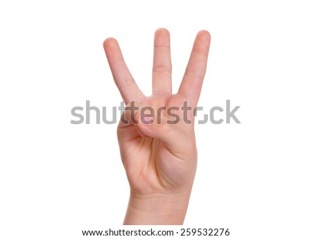 Baby is counting by fingers. The number three is shown - stock photo