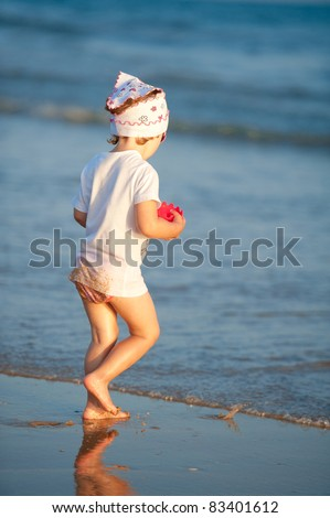 Baby is having fun on the beach