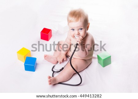Baby is holding a stethoscope on a white background - stock photo