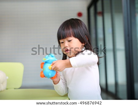 Baby kid girl playing toy in Kid room
