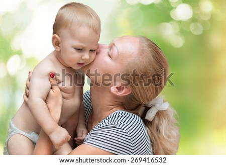 Baby. Laughing baby playing with mother - stock photo