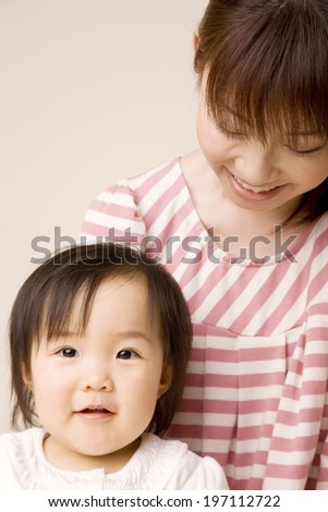 Baby Laughing While Being Embraced By Mother