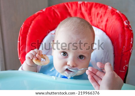 Baby-led weaning with dairy product - stock photo