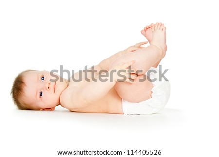 baby lies naked in diapers