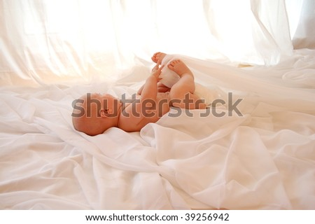 Baby looking out of the window - stock photo