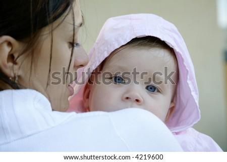 baby looking over mothers back - stock photo