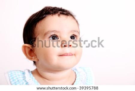 Baby looking up over white background. Luminous image - stock photo