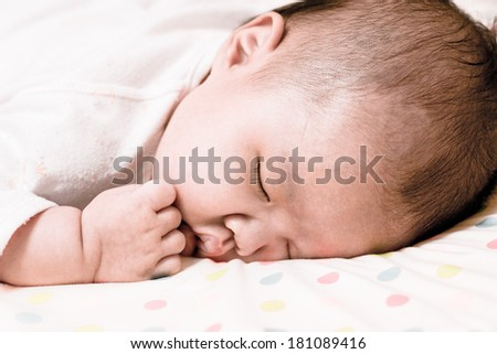baby lying on face downward