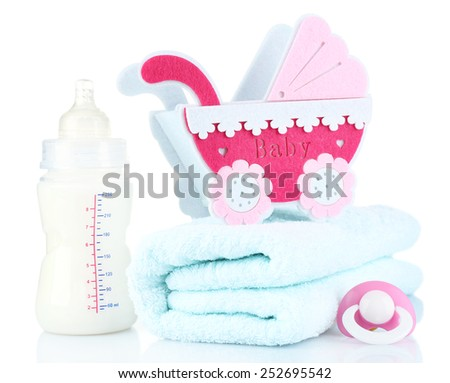 Baby milk bottle, pram and pacifier isolated on white - stock photo
