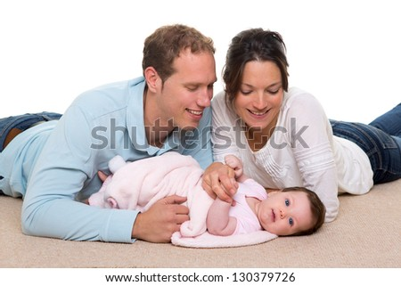 Baby mother and father happy family portrait  lying on carpet and white background - stock photo