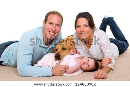Baby mother and father happy family with golden retriever dog on carpet