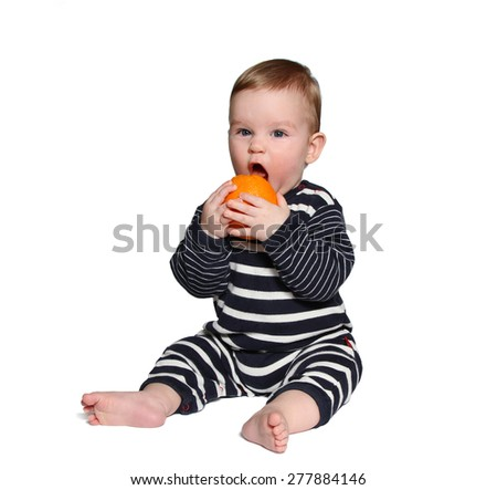 baby mouth is wide open and he is ready to bite orange on white background - stock photo