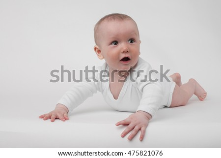 baby on a white background in a white pajamas
