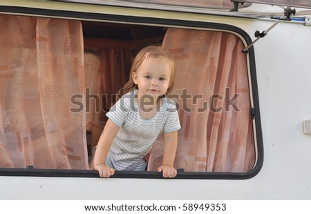 baby on camper - stock photo