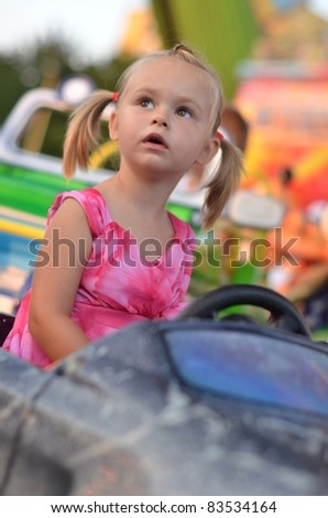 baby on carousel - stock photo