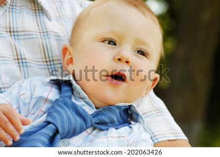 baby on father's hands - stock photo