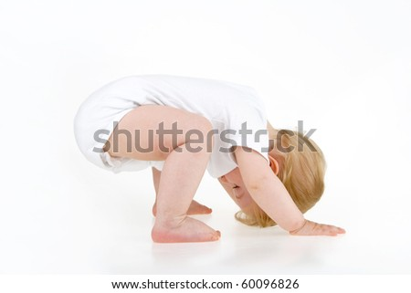 Baby on four on white background. - stock photo