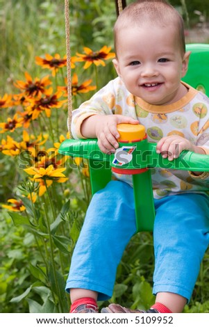 Baby on swing - stock photo