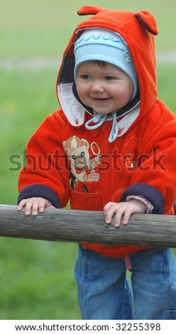 Baby on the wooden swing - stock photo