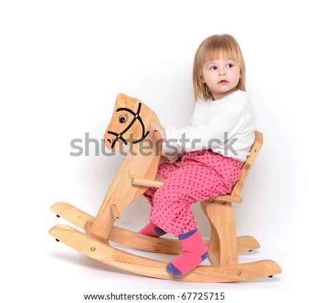 baby on wooden horse - stock photo