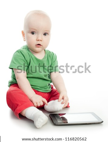 Baby play with the tablet computer - stock photo
