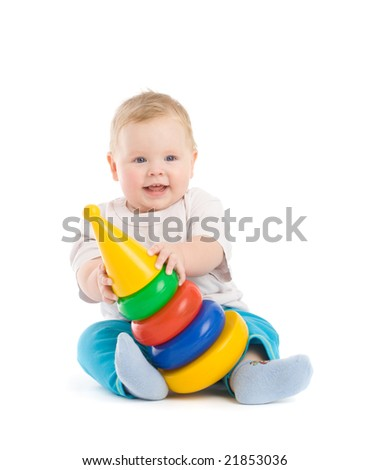 Baby play with tower from colorful discs. Image isolated on white with light shadows - stock photo