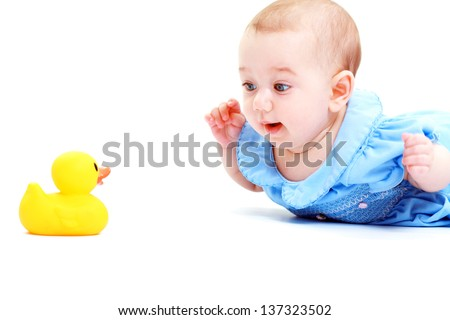 baby play with toy in blue dress smiling - stock photo