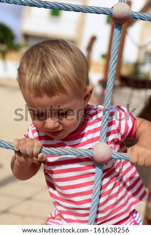 Baby  playing in the playground - stock photo