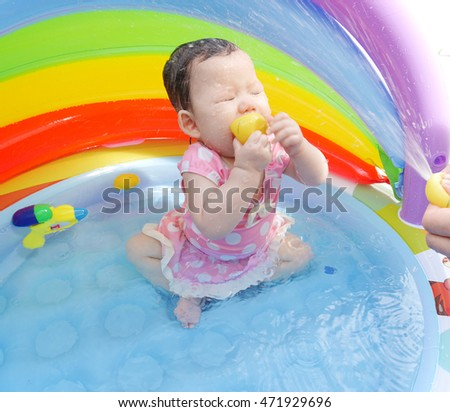 Baby playing in the pool