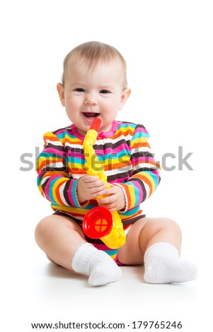 baby playing musical toy - stock photo