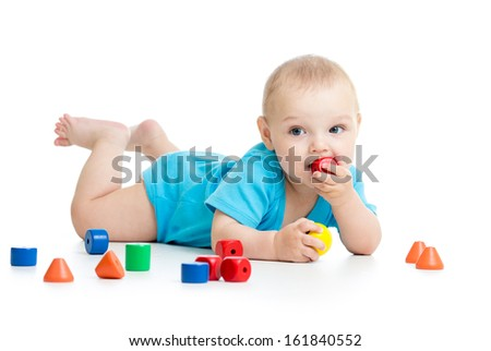 baby playing with block toys - stock photo