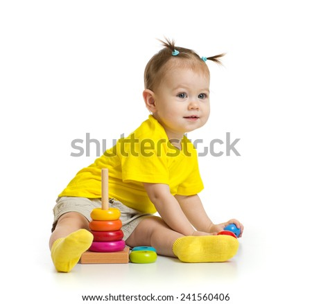 baby playing with colorful tower isolated - stock photo