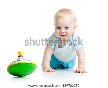 baby playing with toy whirligig - stock photo