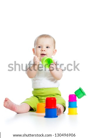 baby playing with toys isolated over white - stock photo