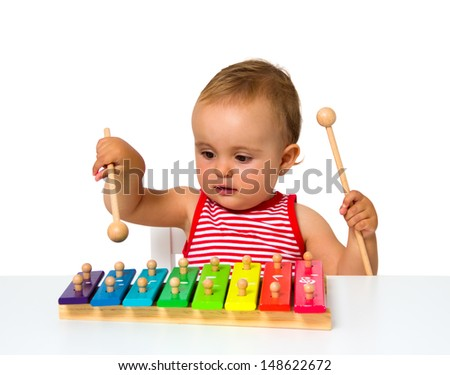 baby playing xylophone isolated on white - stock photo
