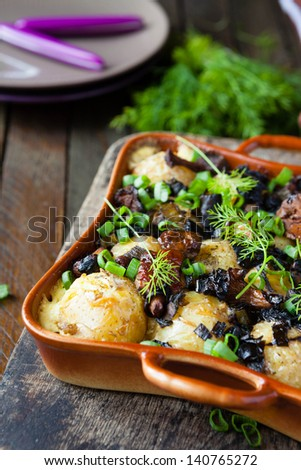 baby potatoes baked with mushrooms, food close up - stock photo