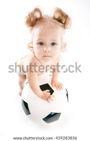 baby rests on a soccer ball - stock photo