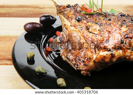 baby ribs served on plate over wooden table - stock photo