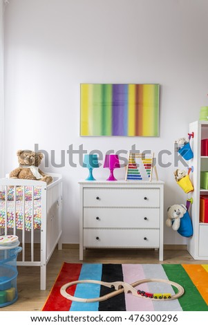 Baby room with colorful toys, decors and carpet