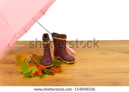 Baby rubber boots umbrella maple leaves floor isolated white background red - stock photo