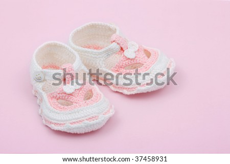 Baby's first booties - stock photo
