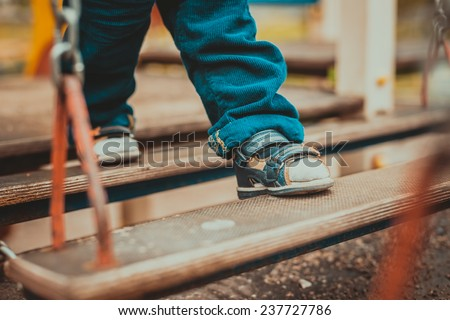Baby's first steps  - stock photo