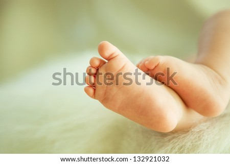 Baby's foot - stock photo