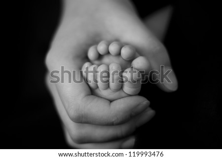 Baby's foot in mother hands